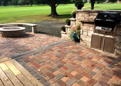 Paver patio with built-in grill and fire pit.
