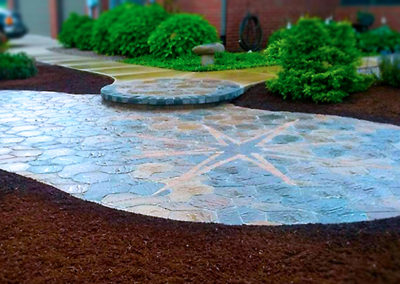 Custom stone paver patio with starburst inlay.