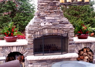 Winter containers with outdoor fireplace.