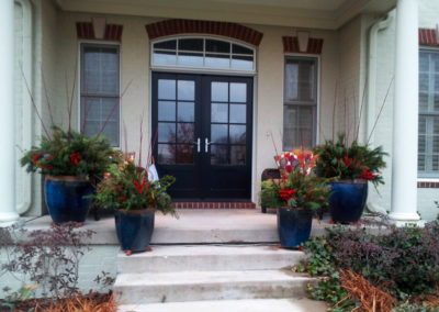 Front porch with winter containers.
